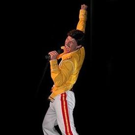 Neil Angus as Freddie Mercury