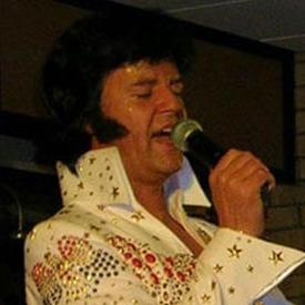 Adam Carter as Elvis