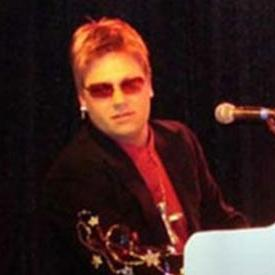 Joel Coombes as Elton John
