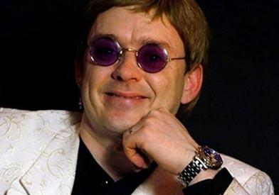 Ricky Morgan as Elton John